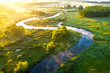 Leinwandbild Motiv Aerial view of beautiful landscape of foggy river and green fields. Sunrise over river in summer