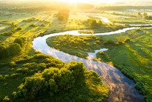 Aerial View Of Beautiful Sunrise Above Foggy River, Green Fields And Rural Road. Sunrise Above Nature Park
