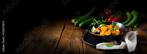 zucchini vegetarian ratatouille with tomato sauce and herbs Canvas Print