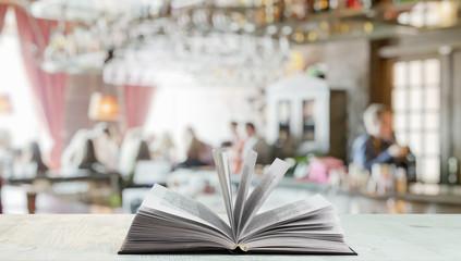 open book in a night club