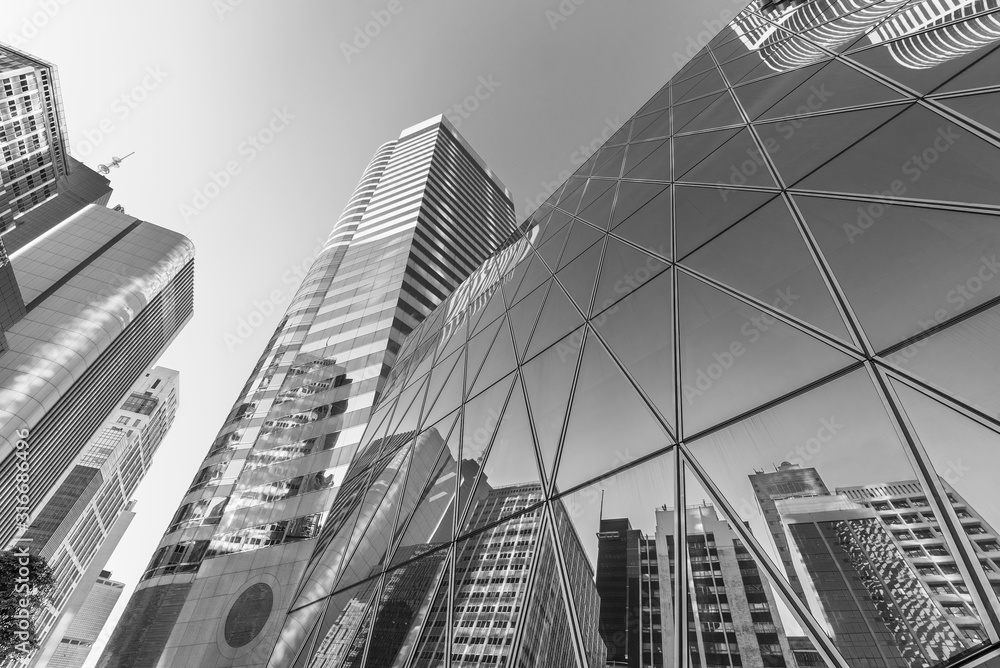 Fototapeta Exterior of modern architecture in downtown. Building abstract background