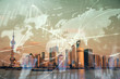Forex graph on city view with skyscrapers background double exposure. Financial analysis concept.