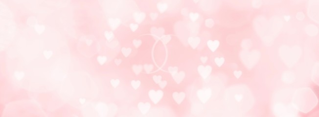 Abstract pink background with hearts and wedding rings - concept wedding, marriage, love