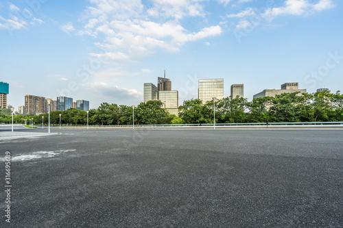 empty urban road with modern building in the city. Canvas Print