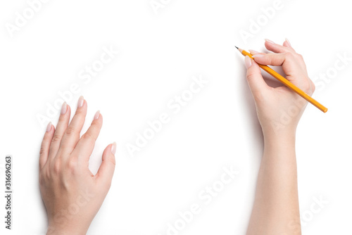 Obraz Female hands holding pencil, isolated on white background. File contains a path to isolation. - fototapety do salonu