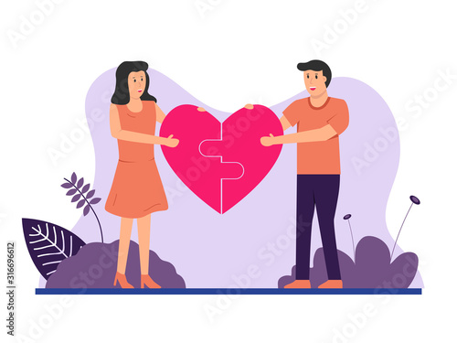Photo Boy and girl assemble a puzzle with a heart