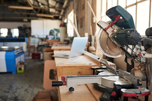 Mitre Saw And Laptop On Workbe...