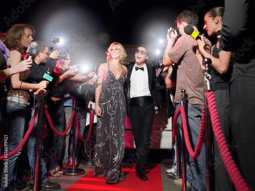 Obraz na plátně Celebrities being photographed by the paparzzi at a re carpet ebent