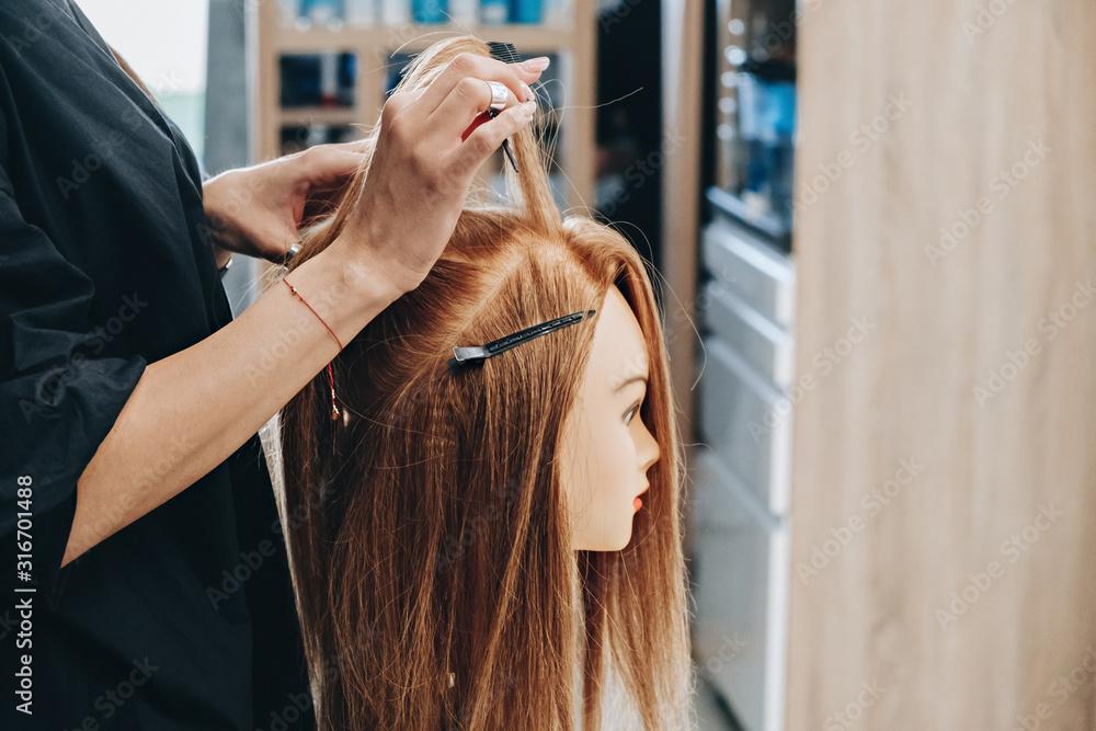 Fototapeta Training hair styling on a mannequin