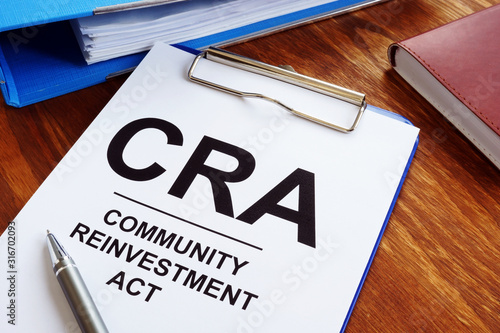 Photo Community Reinvestment Act CRA in the blue clipboard.