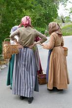 Three Women Wearing Tradiciona...