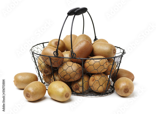 Whole and cut golden kiwifruit/ kiwi (Actinidia chinensis) on white background Wallpaper Mural