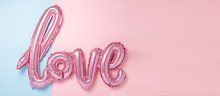 Pink Balloons In The Form Of Word Love On Pink And Blue Background. Valentines Day Celebration. Horizontal Banner