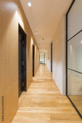 Interior of a long hotel corridor, doorway Canvas-taulu