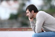 Pensive Worried Man Sitting On...