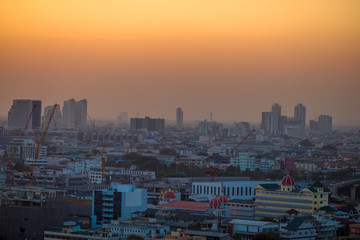 panoramic high-angle evening background of the city view,with natural beauty and blurred sunsets in the evening and the wind blowing all the time,showing the distribution of city center accommodation