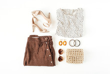 Fashion Collage With Women's Clothes And Accessories On White Background. Skirt With Polka Dot Print, Blouse, High-heels, Bag, Sunglasses, Earrings, Bracelet. Flat Lay, Top View Fashion Beauty Blog.