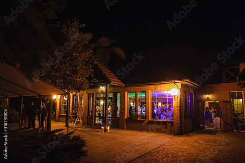 Fototapeta View of restaurants from outside at night. Wedding party