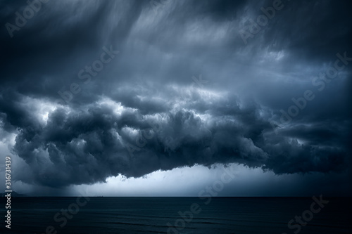 dark and dramatic stormy clouds over sea Slika na platnu