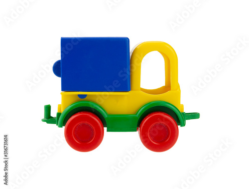 Small plastic toy truck isolated on white background. Side view.