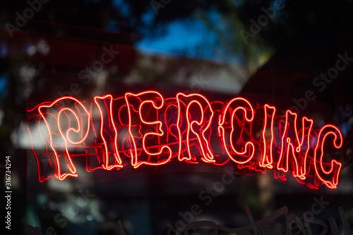 Piercing neon sign