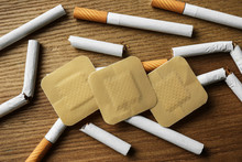 Nicotine Patches And Cigarettes On Wooden Table, Flat Lay