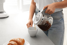 Woman Pouring Coffee Into Cup ...