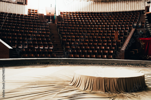 Selective focus of cover on circus arena with seats at background Canvas Print
