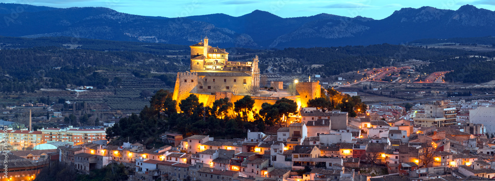 Fototapeta Panorama of Caravaca De La Cruz cityscape and castle, Pilgrimage site near Murcia, in Spain. One of the 5 holy cities in the world