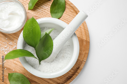 Photo Composition with bath salt on white background, top view