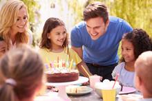 Parents And Daughter Celebrati...