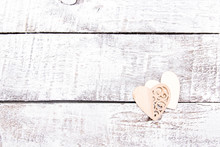Two Wooden Hearts On White Woo...