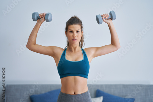 Adult woman working out at home