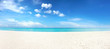 Beautiful beach with white sand, turquoise ocean and blue sky with clouds in sunny day. Panoramic view. Natural background for summer vacation.