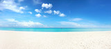 Fototapeta Fototapety z morzem do Twojej sypialni - Beautiful beach with white sand, turquoise ocean and blue sky with clouds in sunny day. Panoramic view. Natural background for summer vacation.
