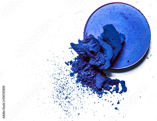 Fototapeta Crushed eyeshadow palette close-up isolated on white background