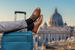 canvas print picture - Tourist has legs on suitcase and relaxing in Rome.