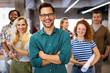 Leinwandbild Motiv Happy business people celebrating success at company