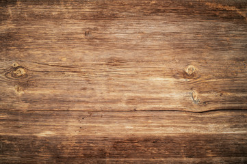 Brown unpainted natural wood with grains for background and texture.