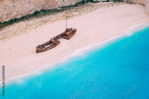 An old rusted ship, wrecked, lies on the seashore. Navagio Bay Shipwreck Beach Greece, Zakynthos