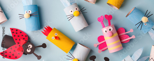 Fotografija Happy easter kindergarten decoration concept - rabbit, chicken, egg, bee from toilet paper roll tube