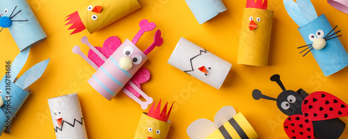 Happy easter kindergarten decoration concept - rabbit, chicken, egg, bee from toilet paper roll tube Canvas Print