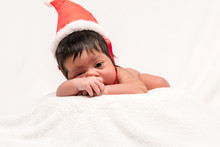 Adorable Mixed Race Newborn Baby In Santa Hat Isolated On White