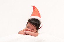 Mixed Race Newborn Baby In Santa Hat Isolated On White