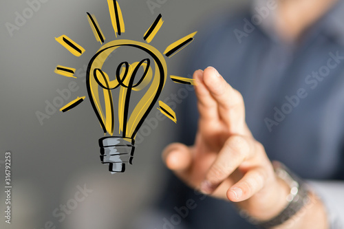 Obraz Bright idea in hand concept design art. - fototapety do salonu