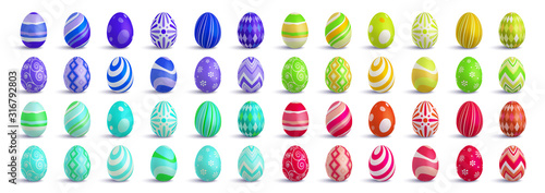 Valokuvatapetti Set of cute colorful 3d realistic Easter eggs on isolated background, decorative