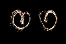 Two Glowing Hearts. Light Painting At Night With A Sparkler. Made With Bulb Exposure