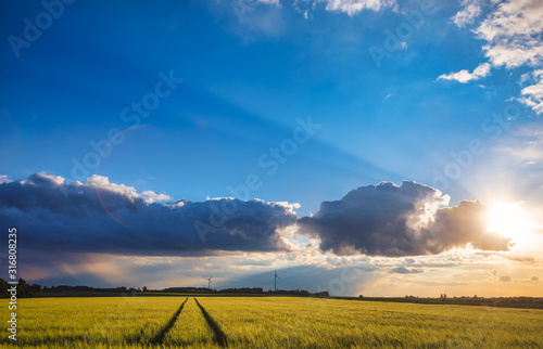 Dramatic evening sky over field in rural Bavaria Germany Canvas Print
