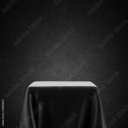 Fototapeta Black and white empty table, spotlight pedestal covered with cloth isolated on b