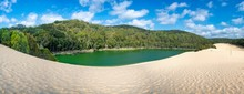 Panorama Lake Wabby On Fraser Island Part Of The Great Sandy National Park Queensland Australia. The Lake Is Thriving With Marine Life And Will Disappear Under The Sand From The Hammerstone Sandblow.